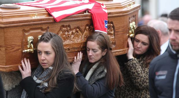 Ryan McBride's coffin is carried by his family