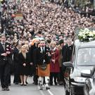 The funeral of Martin McGuinness makes its way through Derry