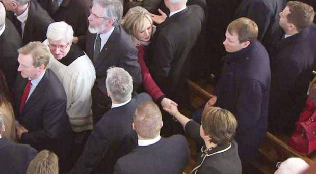 Mrs Foster shakes hands with Sinn Fein's Stormont leader Michelle O'Neill