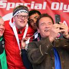 Arnold Schwarzenegger takes a selfie with Cyril and other athletes