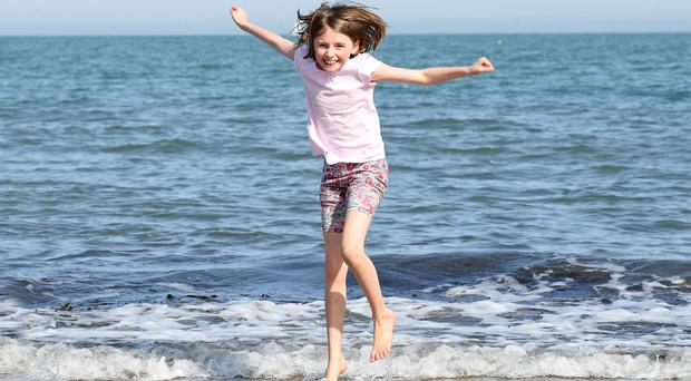 Anna Neill (10), from Belfast, splashing in the tide at Helen's Bay yesterday