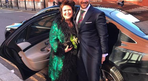 Radio Ulster's Kim Lenaghan with groom Andrew Jones on the wedding day in London