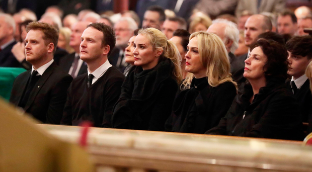 Martin McGuinness's children Emmet, Fiachra, Fionnuala and Grainne, and wife Bernie, at the funeral