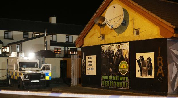 PSNI officers cordon off the scene of the shooting in the Creggan area of Derry