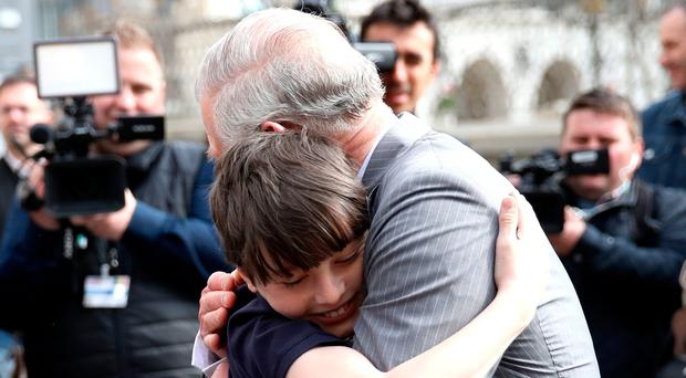 Charles hugs Valentin Blacker, son of his friend William Blacker