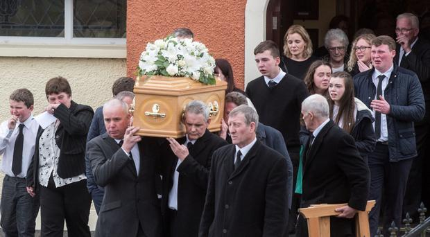 Family and friends at the funeral of Alex McKinley at Gillygooley Presbyterian Church outside Omagh