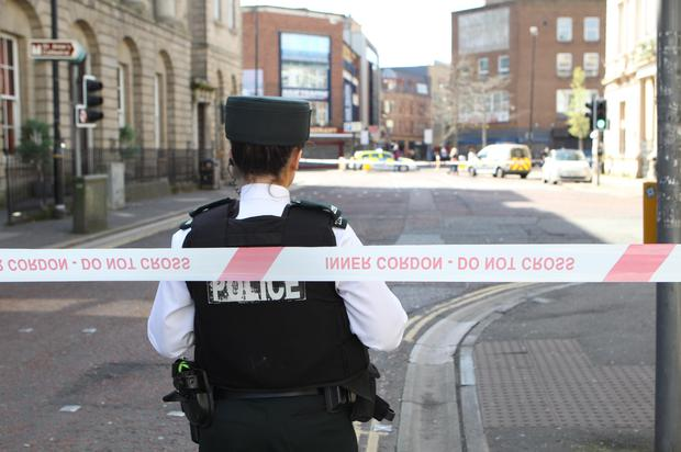 Forensic experts at the junction of Waring Street and Donegall Street in Belfast where an incident took place in the early hours of Sunday morning resulting in Paul McCready's death