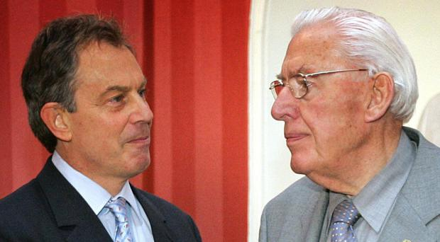 Tony Blair has denied that he authorised security services to tap Ian Paisley's phone