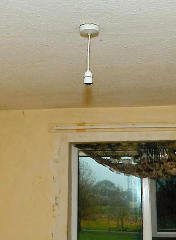 The light fitting, minus a bulb, in the room where his victim was held captive for eight years