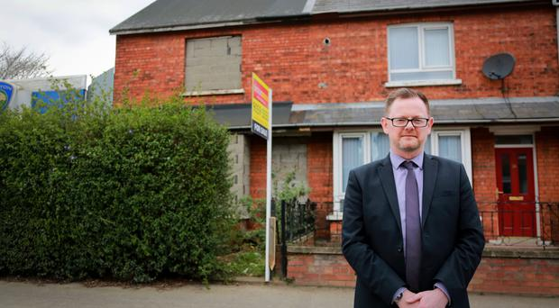 Estate agent Jonathan Dickson at the property in Parkgate Avenue