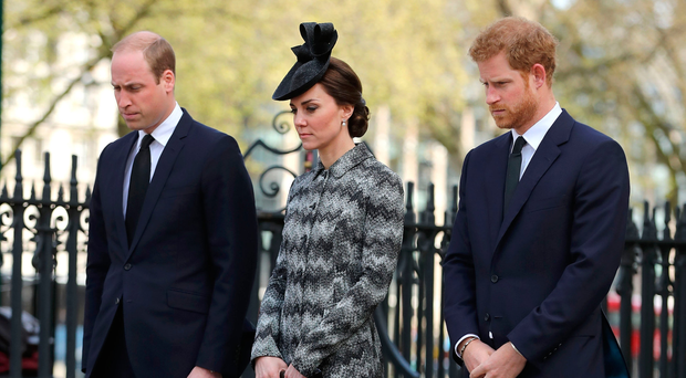 Prince William, Catherine, Duchess of Cambridge and Prince Harry pay their respects. Photo: Dan Kitwood/Getty Images