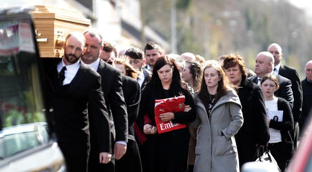 Family and friends carry the coffin of Christopher Martin into The Church of The Immaculate Conception and St Joseph's, Crossgar