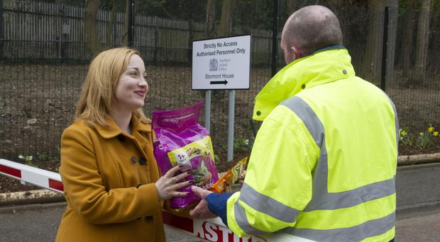 Reporter Victoria Leonard outside Stormont with food for the estate's three cats
