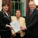 Prof Eileen Evason delivers the report to Arlene Foster and Martin McGuinness in January 2016