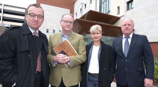 DUP MLAs Christopher Stalford, William Humphrey and Joanne Bunting with Belfast councillor Frank McCoubrey outside Musgrave PSNI station