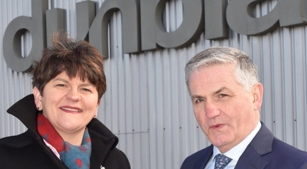 Arlene Foster, then DETI Minister, outside Dunbia with managing director Jim Dobson