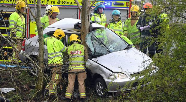 Police and emergency services attend a serious car crash on the M2 yesterday