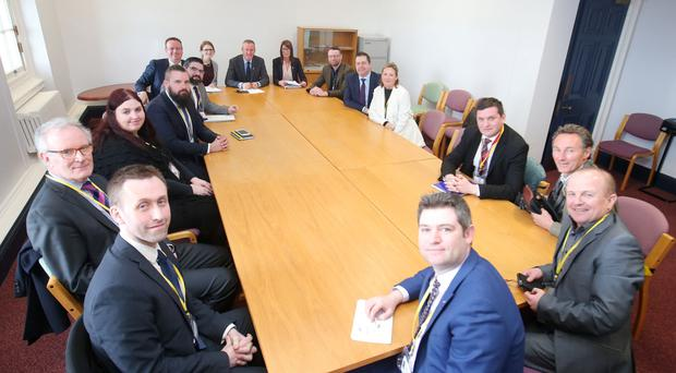 Sinn Fein's Conor Murphy (centre) and some of his party colleagues meet business leaders at Stormont yesterday