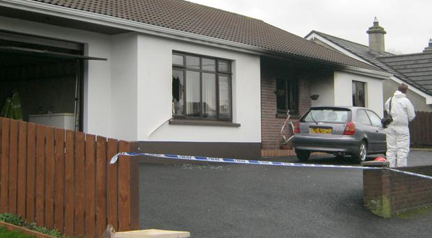 Police at the scene of the house fire at Silverhill Park in Enniskillen