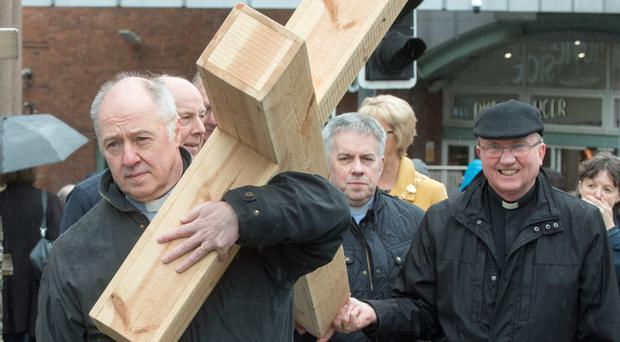 Leaders of the four main churches (from left) Rev Peter Murray, Bishop Ken Good, Rev Michael Russell, and Bishop Donal McKeown lead the Christian Walk of Witness yesterday in Derry