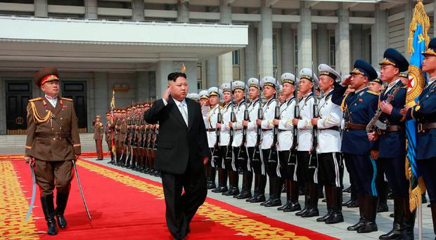 North Korean leader Kim Jong-un arrives for a military parade
