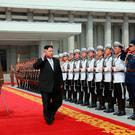 North Korean leader Kim Jong-un arrives for the military parade