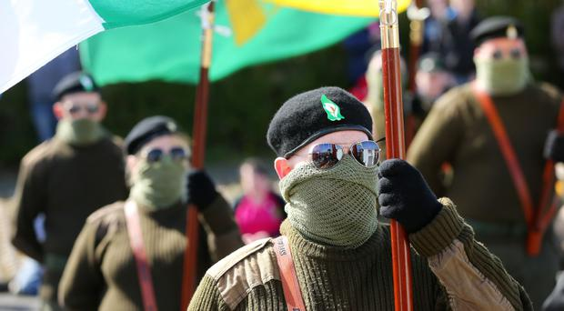 Irish Republicans take part in a traditional Easter commemoration parade in Lurgan