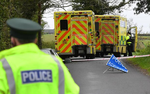 Police and emergency services at the scene of the accident on the Ballymacanallen Road outside Gilford. Photo: Alan Lewis/Photopress