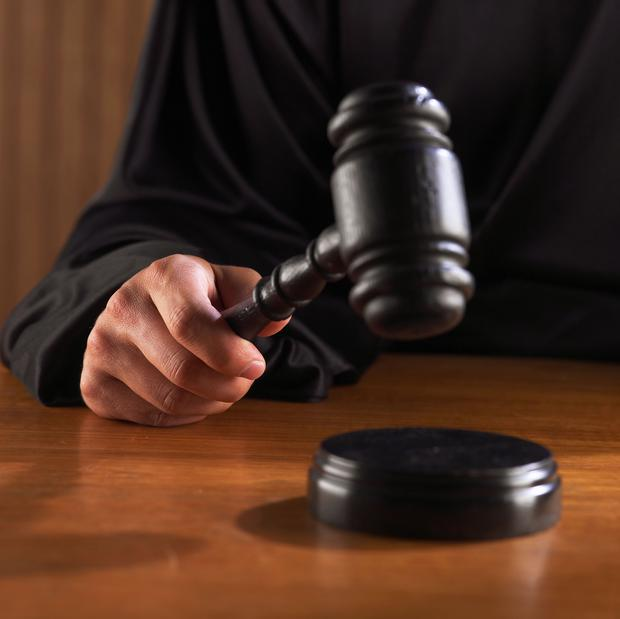 Man tried to spit in an officer's face, court hears