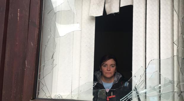 Samantha Kirk surveys the damage to her home in Ballymena