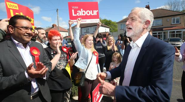 Labour leader Jeremy Corbyn speaking to party activists on the general election campaign trail in Warrington