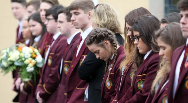 Pupils of St Patrick's Grammar, Downpatrick pay tribute at the funeral of student Conall O'Hare, who was killed on the roads last week