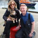 Nicola and son Nyloh with boatman Shane Mawhinney, who saved Bazil after he got into difficulties in Portrush harbour