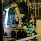 A bomb disposal robot deals with the device