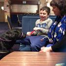 Joe McCann and his mum meet assistance dog Dougal