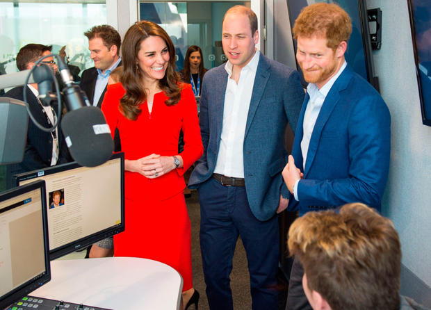 The Duke and Duchess of Cambridge and Prince Harry tour a radio studio during a visit to open the Global Academy in Hayes, London, in support of the Heads Together campaign