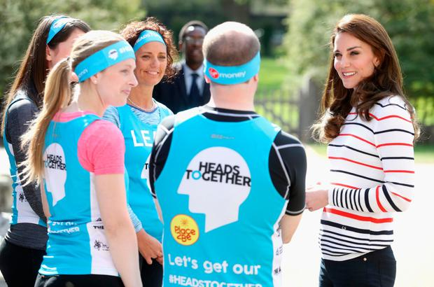 The Duchess of Cambridge with runners from Team Heads Together ahead of the London Marathon.
