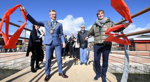 Lord Mayor of Belfast, Alderman Brian Kingston, and Julie Harrison, NI Chair of Big Lottery Fund, untie a ribbon at the opening to the public of the final section of the Connswater Community Greenway (Handout/PA)