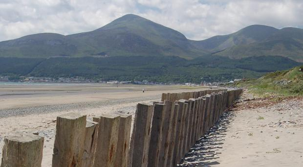 A third of Northern Ireland holidaymakers say they are planning to stay in the UK this year, rather than travel abroad