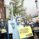 Amnesty International hold a protest to mark US President Donald Trump's first 100 days in office outside the US Embassy in Belfast