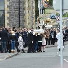 The funeral cortege for teenager Elle Trowbridge leaves St Mary's Church, Killyclogher, yesterday