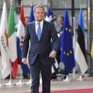 European Council president Donald Tusk arrives for an EU summit at the Europa building in Brussels (AP)