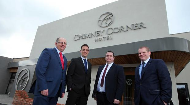 From left to right, Stephen Carson, Group Operations Director, Loughview Leisure; Gordon Davidson, Relationship Director, Ulster Bank; Andy Tew, Relationship Manager, Ulster Bank; and Christopher Kearney, Loughview Leisure Group Finance Director, outside the Chimney Corner hotel (JComms/PA)
