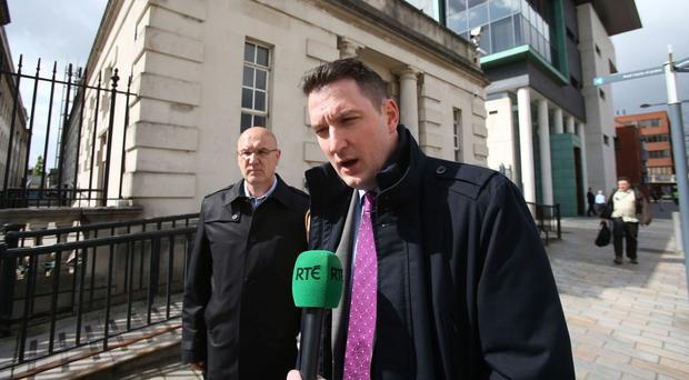 John Finucane (centre) will try to unseat outgoing Democratic Unionist deputy leader Nigel Dodds
