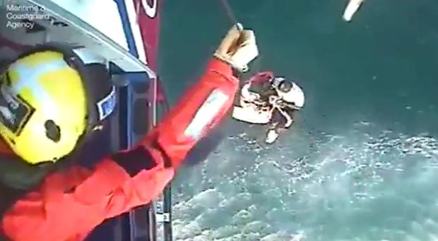 Surfer Matthew Bryce is rescued from the Irish Sea on Monday evening