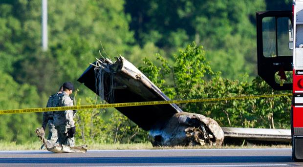 Part of a cargo plane lies on the ground following a fatal crash at Yeager Airport in Charleston