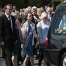 Kevin Carey's family walk behind his coffin following funeral mass at St Oliver Plunketts church, Clady