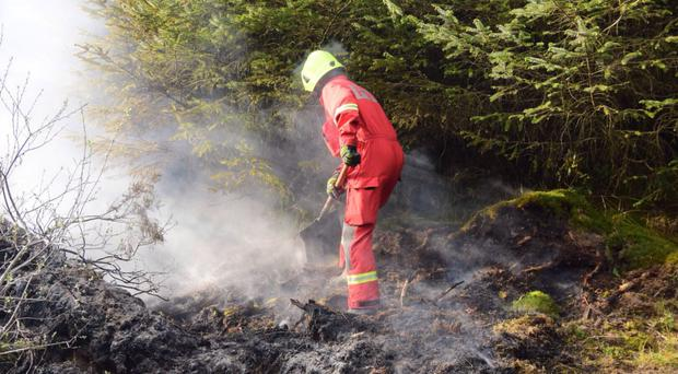 Emergency workers tackle a large gorse fire spreading across the border in Co Tyrone and Monaghan