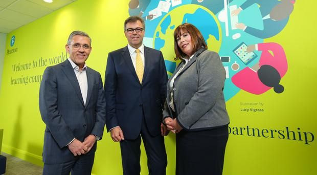 Gareth Morgan of Pearson, Invest NI chief executive Alastair Hamilton and director and centre lead of Pearson Finance Services Suzanne Willmott (Invest NI/PA)