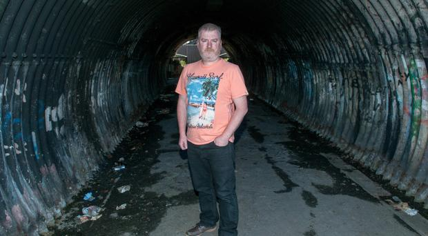 Independent councillor Warren Robinson in the tunnel where his brother Mark was beaten to death 16 years ago